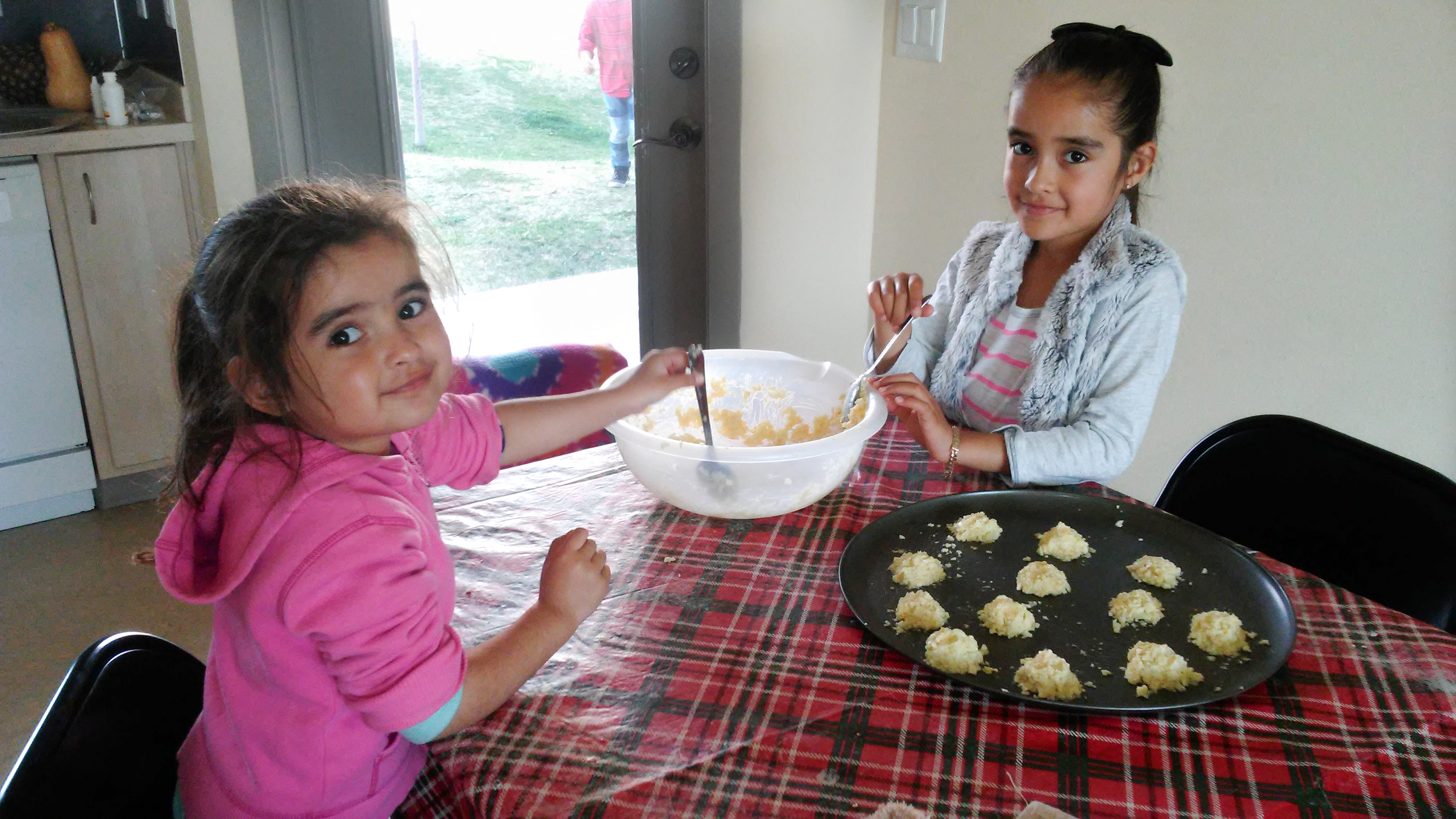 Image of girls making Food Hero recipe at home