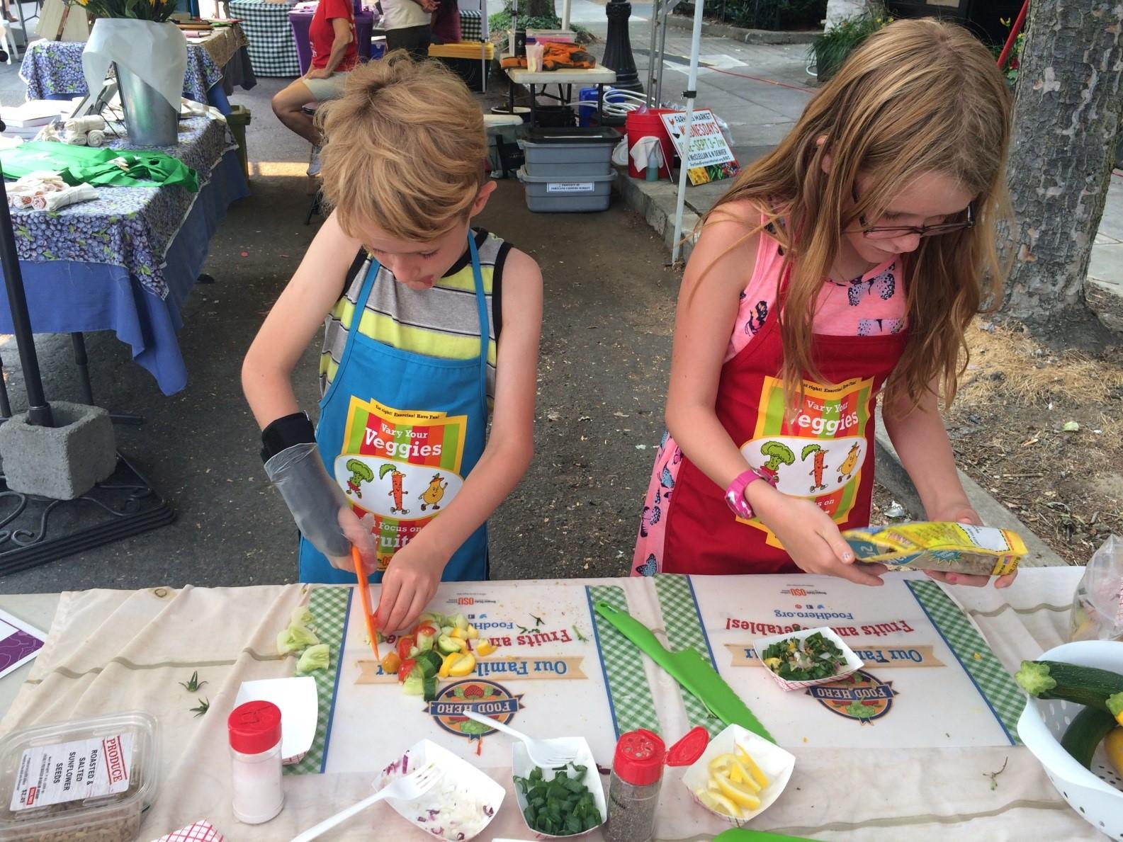 Cutting Vegetables at the Farmers Market