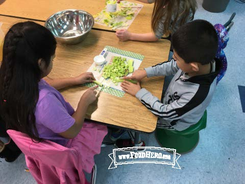 Kids preparing a salad