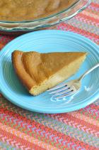 Phot of served pumpkin pie slice
