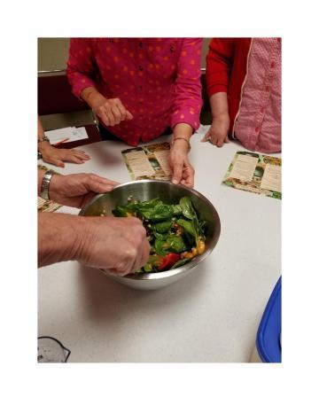 Seniors Making Spinach Pasta Salad