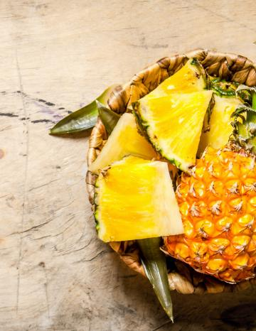 Cut Pineapple on Wood